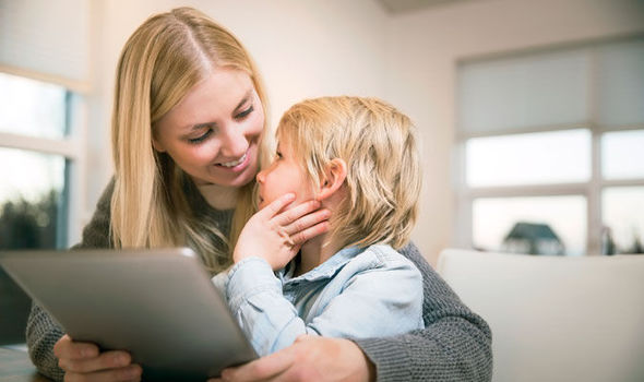 Adult reading to child from electronic tablet